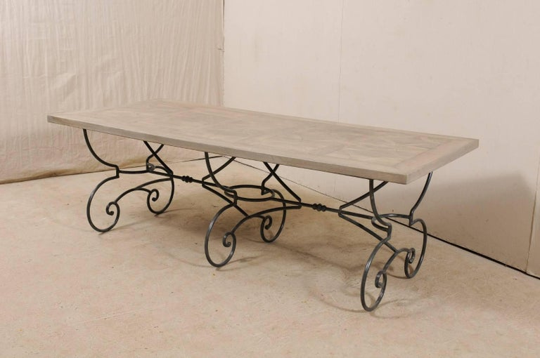 Lovely French Vintage Table with Inlay Wood Top On Large Scrolling Iron Base For Sale 2