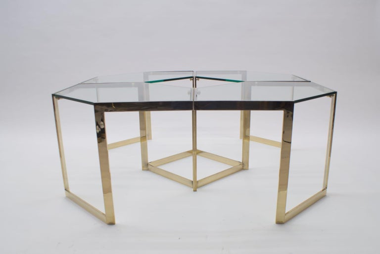 A very elegant set of 4 side tables. The tables can be placed in countless formations. The pictures show only a few possibilities. Very good, heavy quality. With a natural patina that comes with time. See pictures. The tables assembled to a coffee