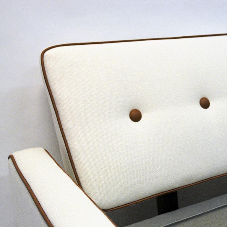 This unique and lovely vintage sofa and bed sofa was produced by IRE Möbler (still active today) in the 1950s, Sweden. The back is removable in which makes this a perfect extra bed as well. The sofa is newly upholstered in a lovely Norwegian cream