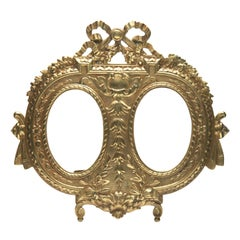 'Lover's Knot' Double Picture Frame; Polished Brass. made by J.H. France, 1900s