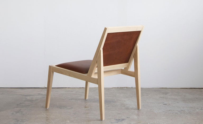 Inspired by the classic proportions of the Danish modern era, the Low Back Lounger achieves comfort and beauty through simplicity. The seat is upholstered in our signature leather, offered in five unique color options and finished by hand in house.
