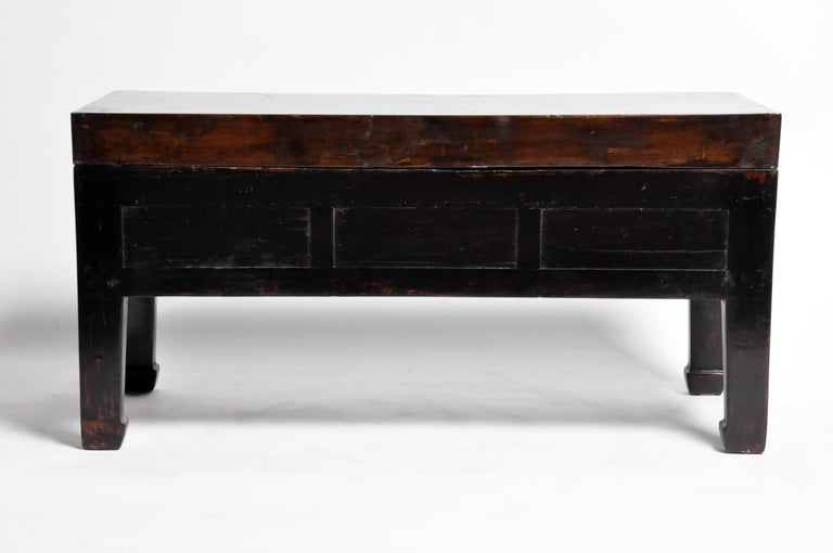 This handsome low table is from Jiangsu, China and was made from reclaimed elmwood and terracotta. The piece features mortise and Tenon joinery, three drawers, and a terracotta top. You can also customize it and make it your own. Wood, color,