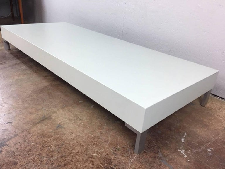 Very well built low coffee table or art or sculpture display table. Believed to be B&B Italia. The color of this table is fairly represented in the photos. It is a very pale, very slight and faint hint of mint color. This table is heavy and
