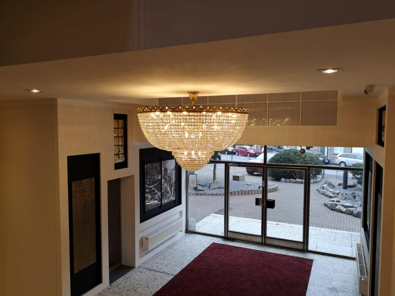 New Montgolfière style chandelier Empire style smaller larger possible. Lead crystal. - House production. Made in Berlin. - Available in several sizes Measures: Diameter 64 cm, high 45cm, 11 x E14 bulbs. Low flush mount crystal chandelier Empire big