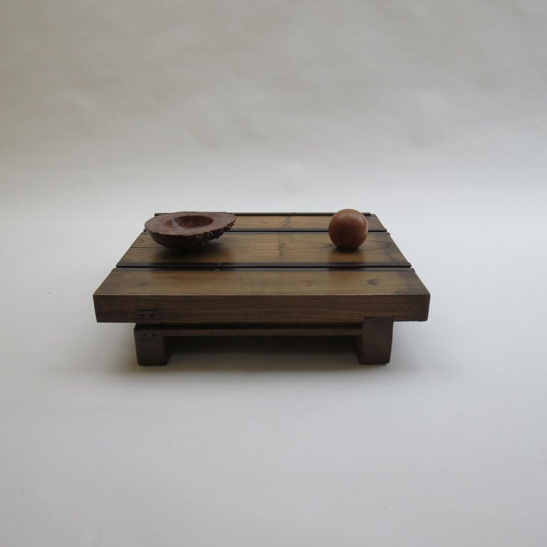 Wooden Japanese table with metal guides. Made from one piece of solid elm with metal guide inserts to the top.  Good heavy piece with very nice patination and color. Dates from early 20th century.  ST1160.