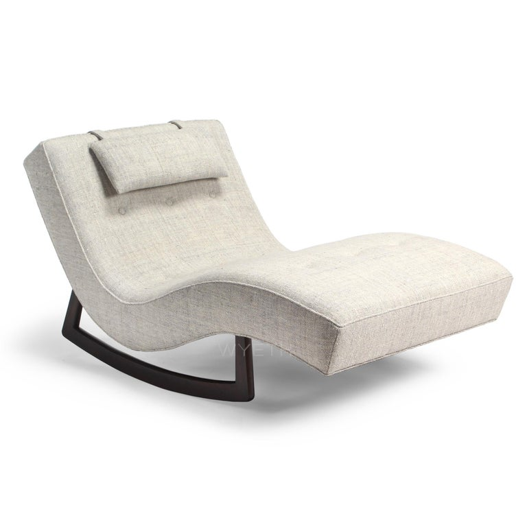 A sinuous and generously scaled upholstered rocking chaise lounge.
