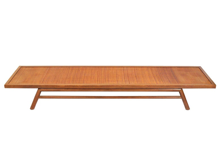 Low slung coffee table or bench, designed by T.H. Robsjohn-Gibbings for Widdicomb, American, circa 1950s. As you can see in the last period photo, Gibbings seems to have preferred it as a bench. We can make a cushion for this in your fabric for an