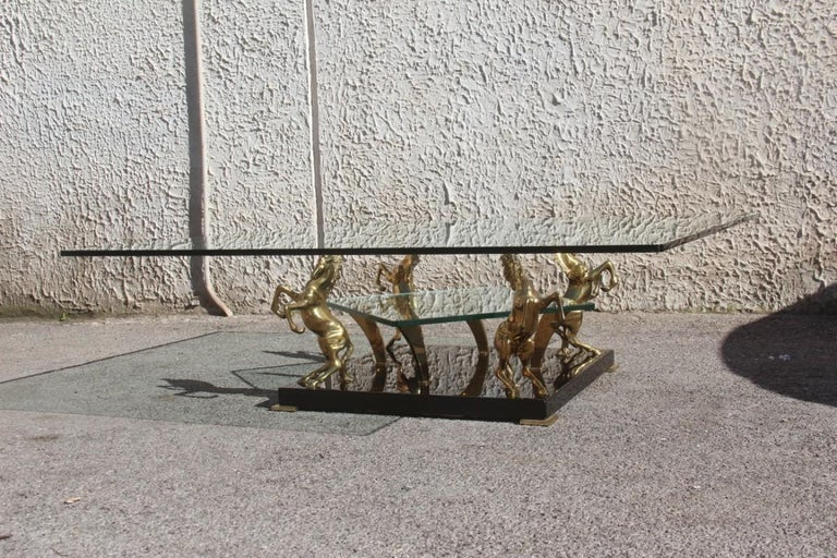 Low square glass coffee table and 24-karat golden brass horses 1970 Italian design, black and gold.