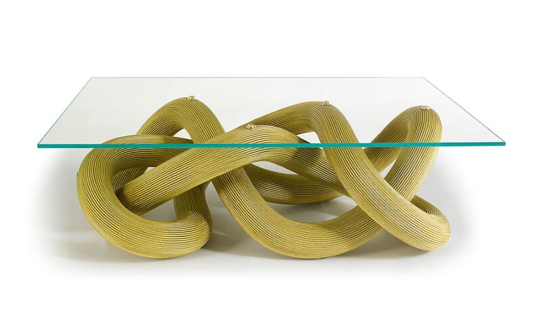 Inspired by the playful yet dynamic nature of a firework sparkler, the Flux low coffee table is a unique sculptural piece of furniture using a single energetic line that flows as an infinite and unsupported loop.   This singular loop is made up of