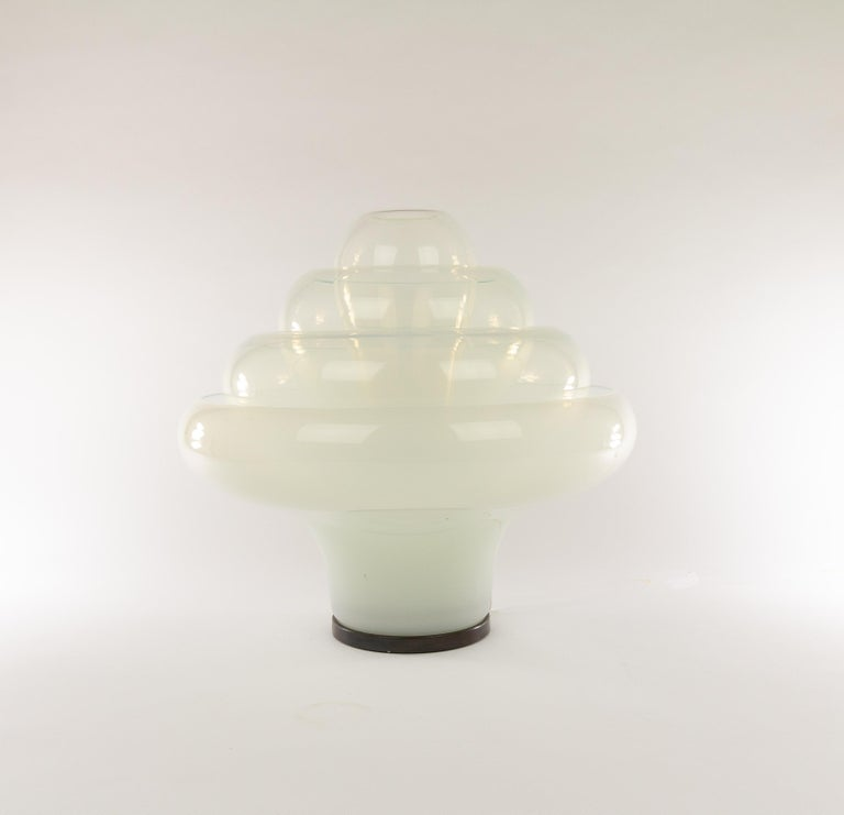 Mesmerizing table lamp, model LT 305, by 'glass magician'Carlo Nason for A.V. Mazzega in the 1960s.  This ingenious object, nicknamed Lotus, consists of four interlocking individual glass shades,one central light bulb and ametal support
