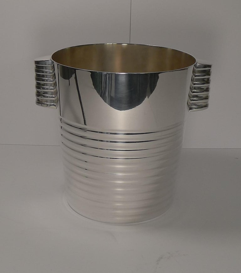 A fabulous Art Deco silver plated Champagne bucket designed by the celebrated Luc Lanel for Christofle, circa 1935.  The design is called