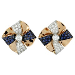 Luca Carati 18K Rose and White Gold Diamond and Sapphire Pave Bow Huggie Omega
