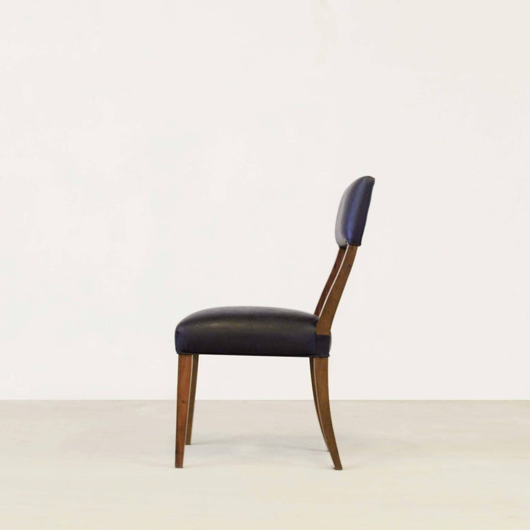 Costantini prides itself in using the hardest and most beautiful hardwoods in the construction of its line of seating. Shown in Argentine rosewood and black leather, the Luca chair's gently curved, high back exudes elegance and