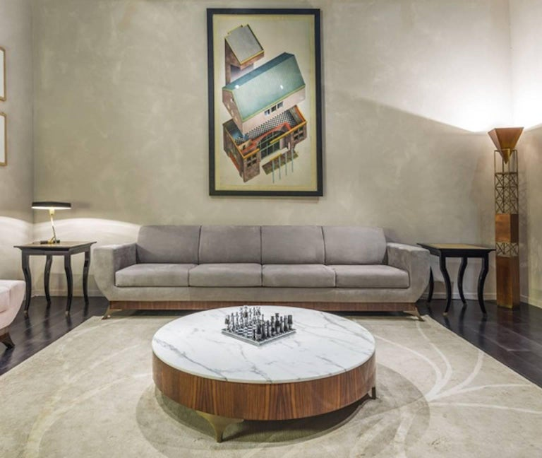Round coffee table in polished rosewood with Calacatta marble top designed by Luca Scacchetti for oak, Italy.  Biography Luca Scacchetti was born in Milan in 1952 where he graduated from the Architecture Faculty of the Polytechnic in 1975 with a
