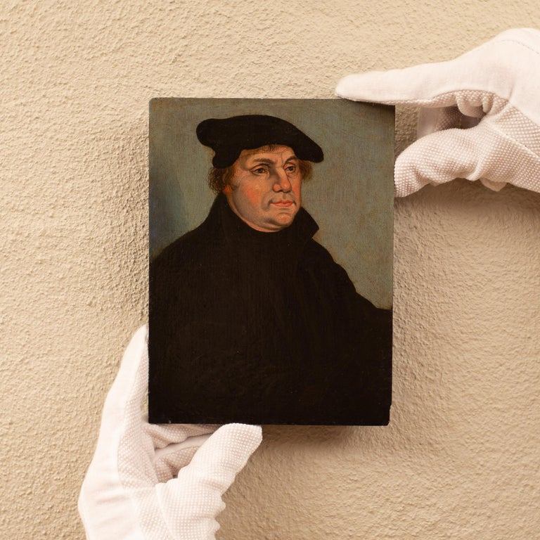Portrait of Martin Luther by a Follower of Lucas Cranach the Elder, Oil on Panel - Old Masters Painting by Lucas Cranach the Elder