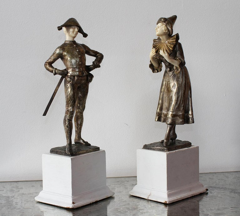 LUCE  Beautiful and very glamour pair of 1920 sculptures depicting Harlequin & Columbine, France, 1920 The bronze has a beautiful original silver and gold patina and the bone carving is very delicate, principally in the Columbine fingers and both