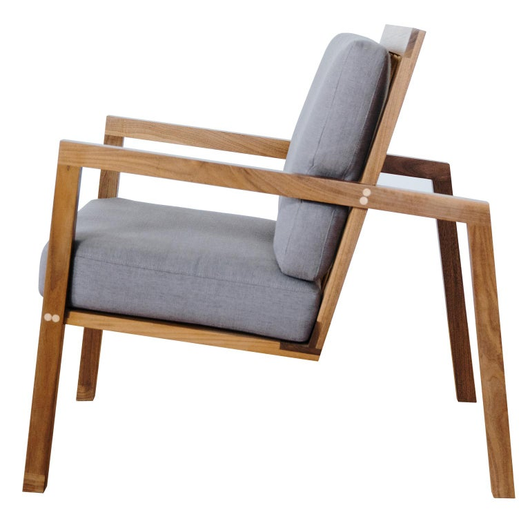 The Luchtig lounge chair is an ode to Classic Danish furniture with a slight architectural twist. The chair is designed to achieve a weightless, yet significant profile. The frame features angular, splayed legs, with a spindled back, and floating