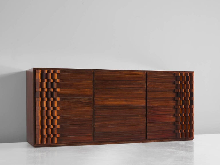 Luciano Frigerio cabinet rosewood, Italy, 1970s.  This Postmodern credenza is designed with a complex 3D pattern of squares that create a wonderful play of shadow and light on each corner of the sideboard. The 'blocks' create a strong graphic and