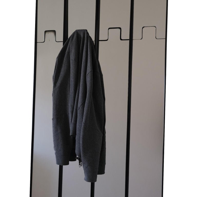 Luciano Bertoncini, a Wall Mirror and Coat-Rack,