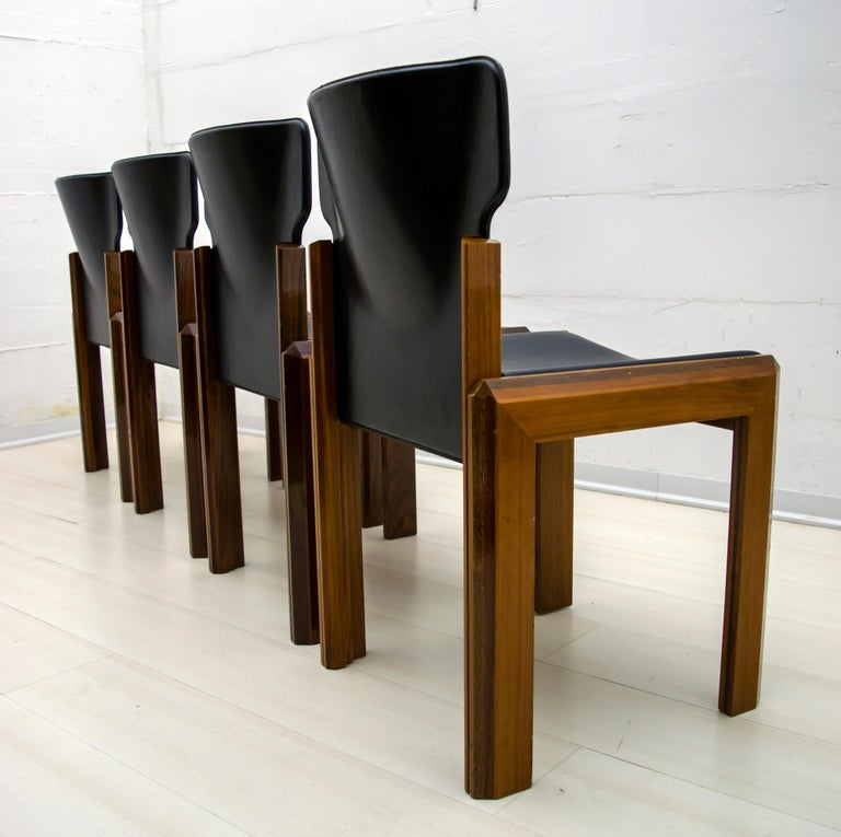 These dining chairs were designed by Luciano Frigerio. The chairs are veneered with various woods: Walnut, Mahogany, Padouk, Wenge. There is also a table combined with chairs, always produced by Frigerio  Luciano Frigerio was born in Desio in