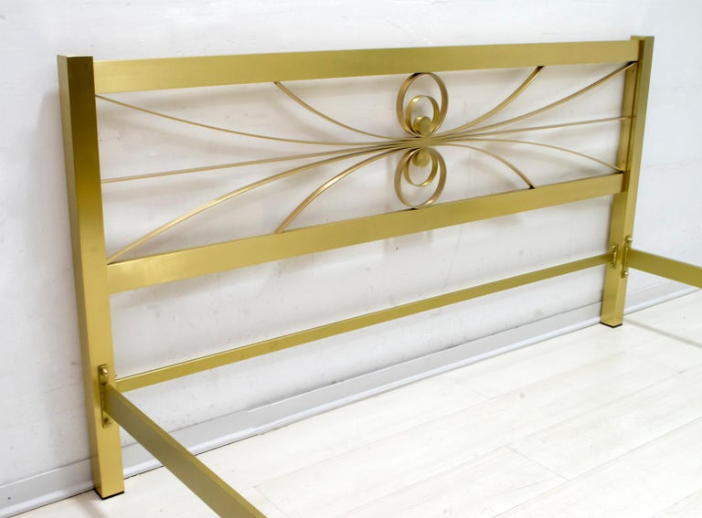 Elegant double bed designed by Luciano Frigerio, Italy, 1970s, in good original condition, bed kept in a warehouse of a furniture factory. The decorative section includes metal crosspieces with a gold finish.