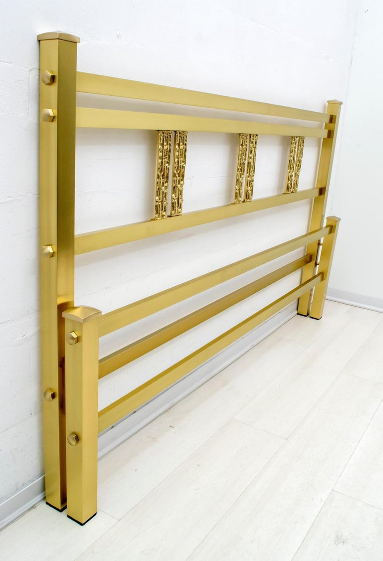 Elegant headboard designed by Luciano Frigerio, Italy, 1970s. This is an elegant headboard, in good original condition, bed kept in a warehouse of a furniture factory. The decorative section includes crosspieces with a smooth brass finish, the