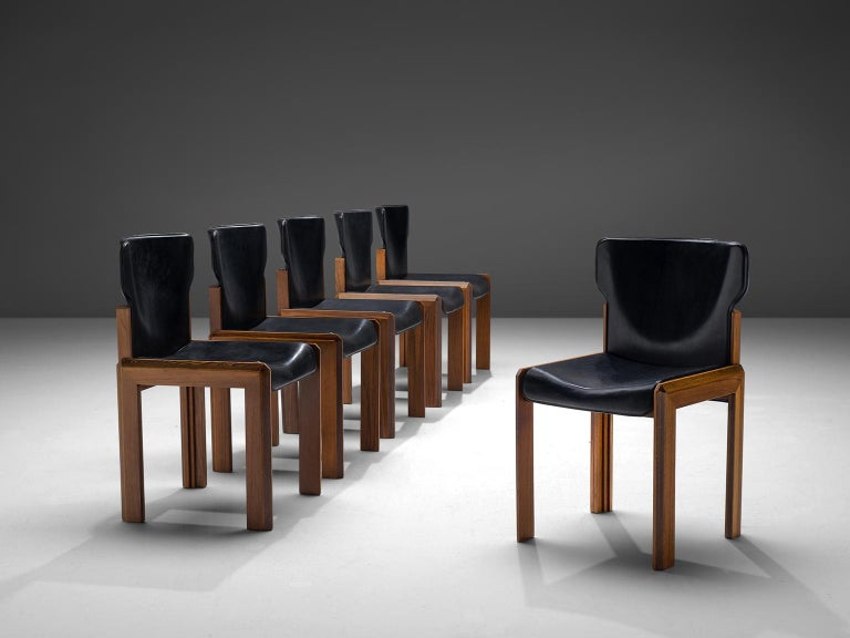 Luciano Frigerio, set of six leather 'Pagani' chairs in various woods, Italy, circa 1975  These chairs are built up of a frame with laminated, marqueterie of noble woods. The chairs have a dent seat and bac. These stylistic choices result in a