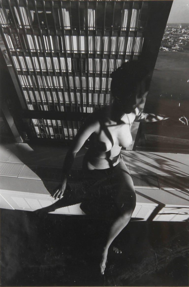 Artist: Lucien Clergue, French (1934 - 2014) Title: Nude on a Ledge Year: circa 1977 Medium: Gelatin Silver Print, signed in ink verso Size: 11.5 in. x 7.5 in. (29.21 cm x 19.05 cm) Frame Size: 18.5 x 14 inches