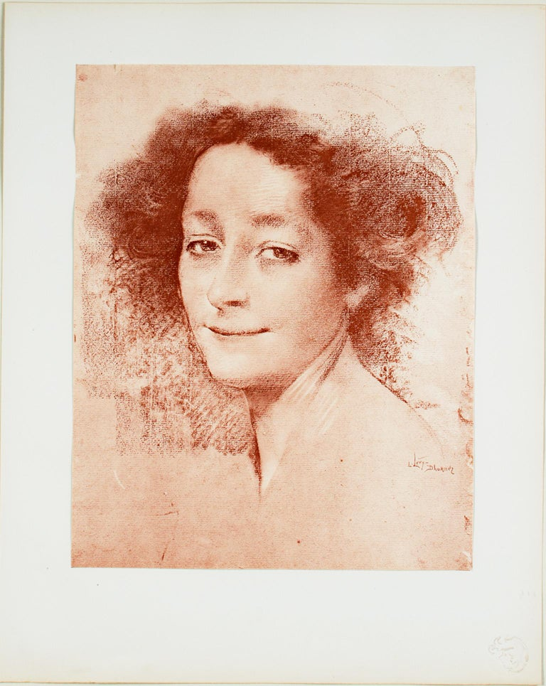 """""""Belle D'Antan"""" is an Estampe Originale, originally published in """"L'Estampe Moderne Volume I,"""" created in 1897. It features a portrait of a woman in sepia. The artist signed the piece lower right, and the publication's blind stamp is lower right on"""