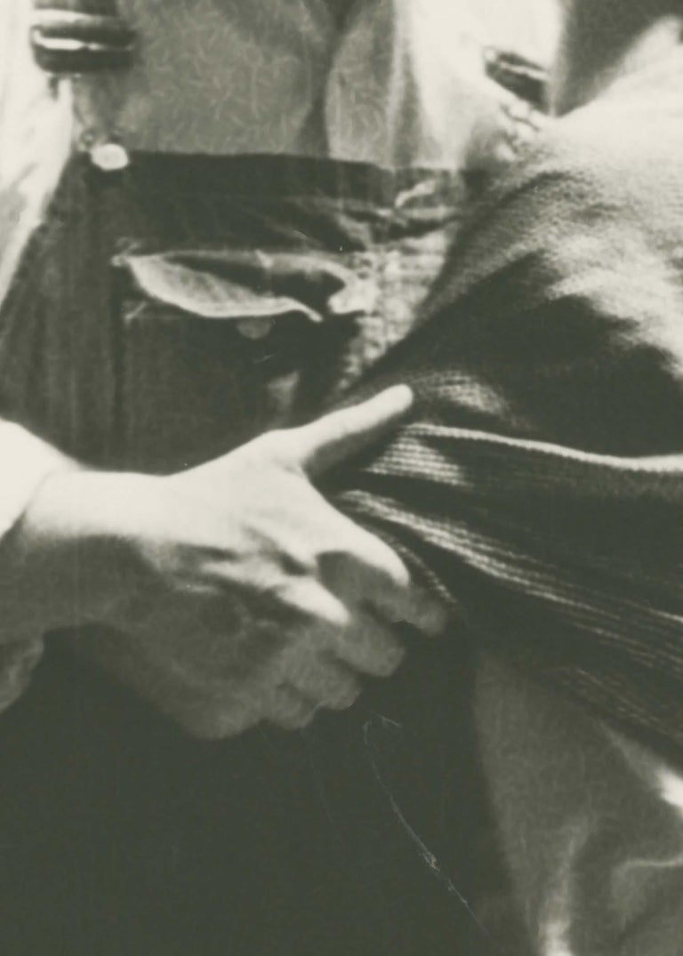 Frida and Diego Kissing - Gray Figurative Photograph by Lucienne Bloch