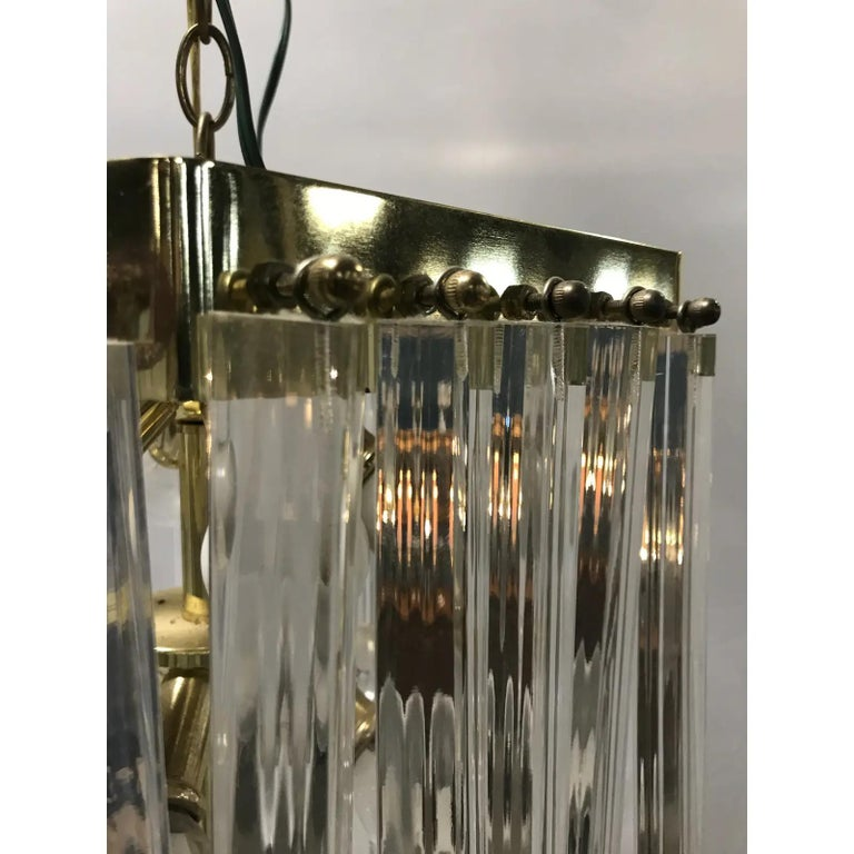 Lucite and Brass Mid-Century Modern Chandelier In Excellent Condition For Sale In New York, NY