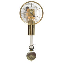 Lucite and Brass Wall Clock by George Nelson for Howard Miller