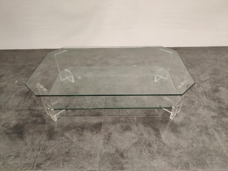 Vintage Lucite and glass two-tier coffee table.  Good condition.  Very modern looking and decorative table that can be combined with lots of interior styles.  Good condition.  1970s - Belgium  Dimensions: Height 35cm/13.77