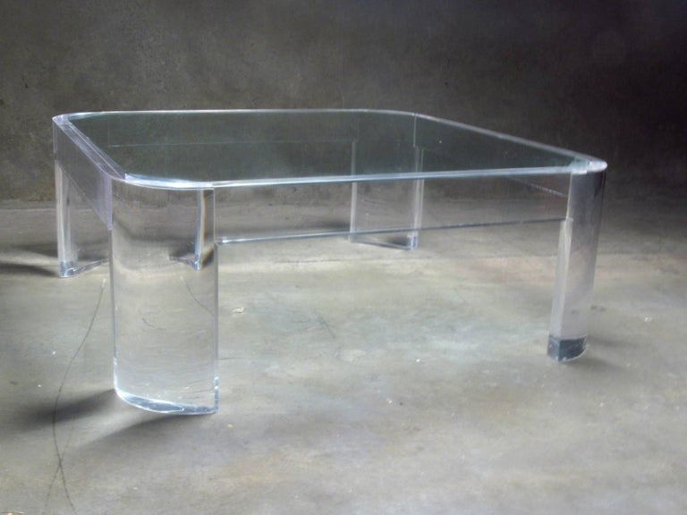 Lucite and Glass Coffee Table by Les Prismatiques, 1970s.   Thick molded Lucite table with radius corners and an inset glass top.