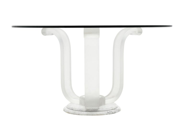 Tripod dining table with a base made of Lucite and marble. The glass circular top is round. We love the lines and quality of this vintage French piece.
