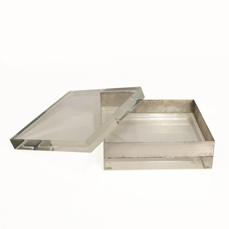 Amazing Lucite and silver squared decorative box. This item was designed in the 1970s.  This piece is made of a crystal Lucite and silver with a crystal Lucite removable top, the way this item reflect the light is just magnificent and makes this