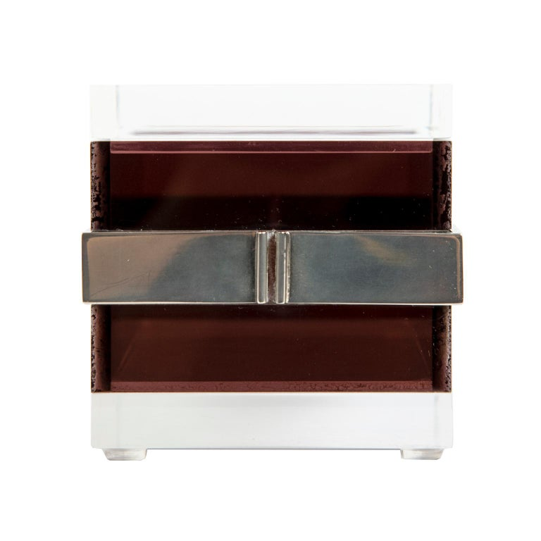 "A clean and sophisticated acrylic box with clear top and bottom with layers of ""chocolate"" brown acrylic with a plated steel middle band.