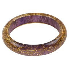 Lucite Bracelet Bangle Gold Metallic Thread Inclusions over Purple Background