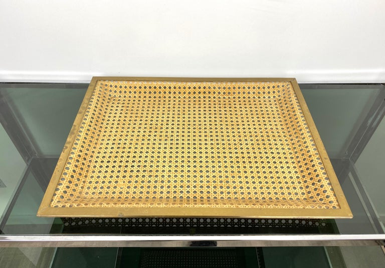 Rectangular serving tray in Christian Dior style in Lucite wicker and brass borders - France, circa 1970. The label shown in the pictures relates to the shop where it was originally sold, which happened to be located in Rome, Italy, during the 1970s.