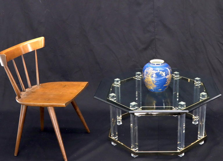 Mid-Century Modern Lucite glass and brass octagon shape coffee center table. In style of Charles Hollies Johns.