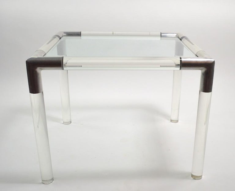 Thick Lucite rods with cast aluminium joinery and original plate glass top, designed by Charles Hollis Jones. This example is in very fine original condition, clean and ready to use. CHJ was known for his ultra chic urbane modern style, which this