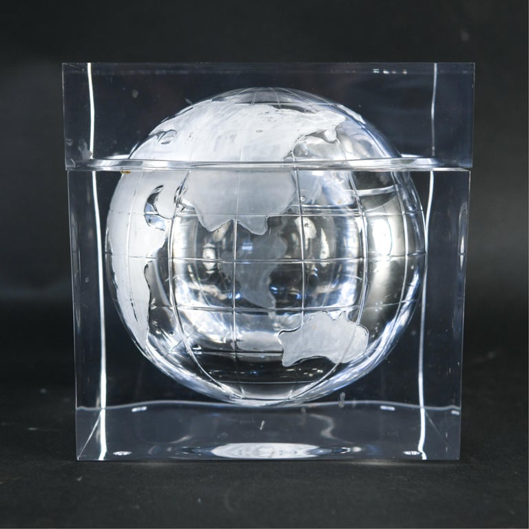 A stylish 1970s Lucite ice bucket with an internal globe form.