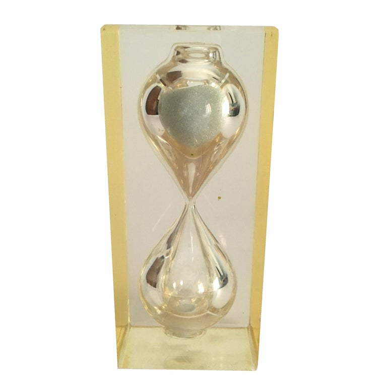 Lucite hourglass paperweight by Pierre Giraudon, circa 1970.