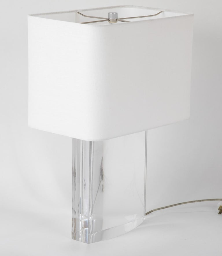 A beautiful Lucite table lamp by Karl Springer.