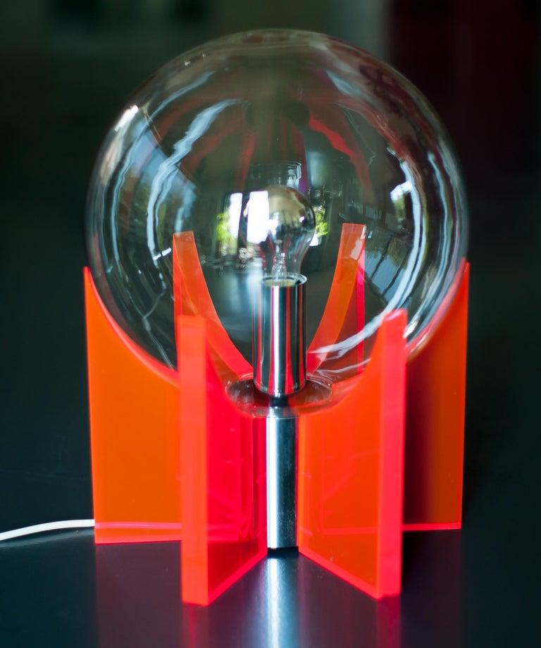 Spectacular table or floor lamp made of red Lucite with a Murano glass sphere. Both Ingo Maurer and Gae Aulenti designed similar lights, but this design is clearly different and unique. Like the King Sun lamp by Gae Aulenti, the light is