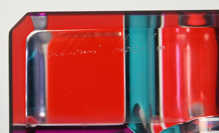 A stunning Pop Art Lucite sculpture by Shlomi Haziza. The cube sculpture is comprised of colored Lucite which refracts light on top of the black pedestal base. Signed Shlomi Haziza, as shown in images. Some minor scratches to the surface but not
