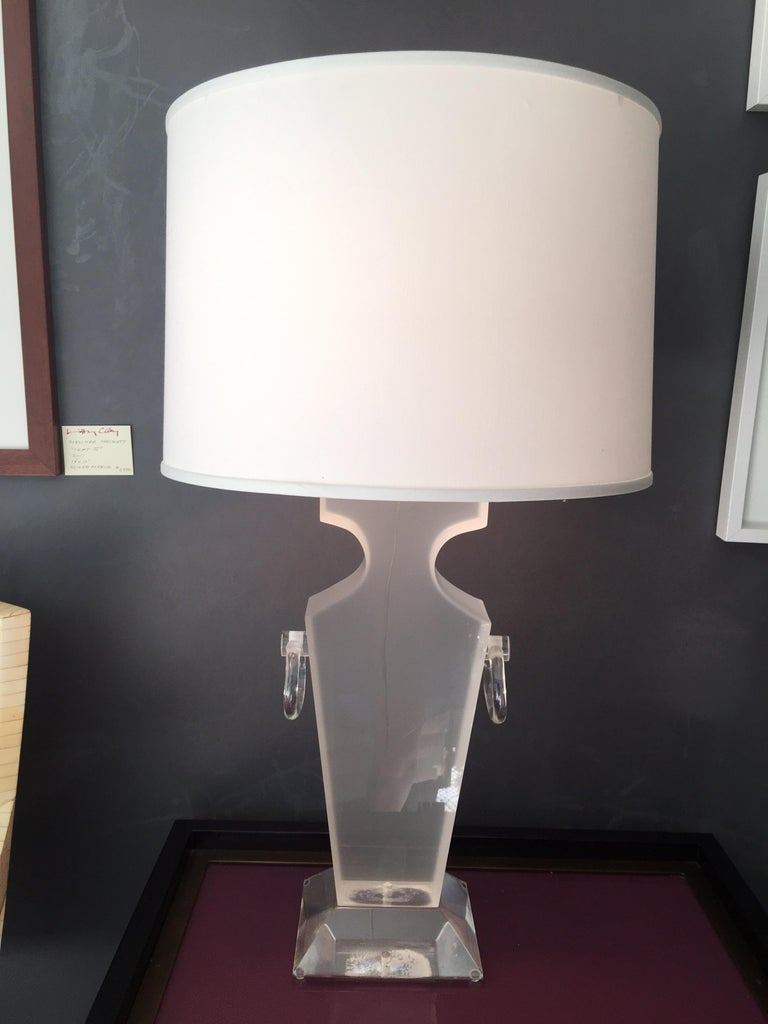 Beautiful Lucite urn shaped lamp by Karl Springer. (A second one is available but missing the chrome adjustable part which holds the shade). New drum shade comes with lamp unless otherwise advised. Measures: 7.5
