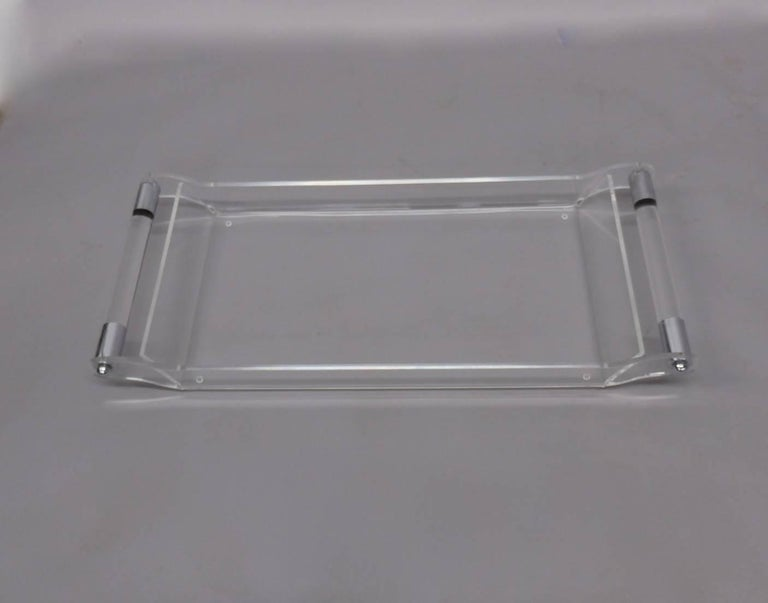 Cleverly formed Lucite tray with chrome trimmed Lucite bar handles. Slight scratches.