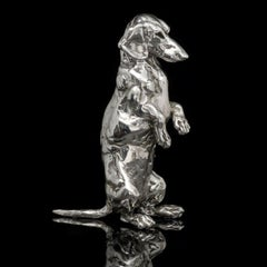 A 'Seated Dachshund' sterling silver sculpture by Lucy Kinsella