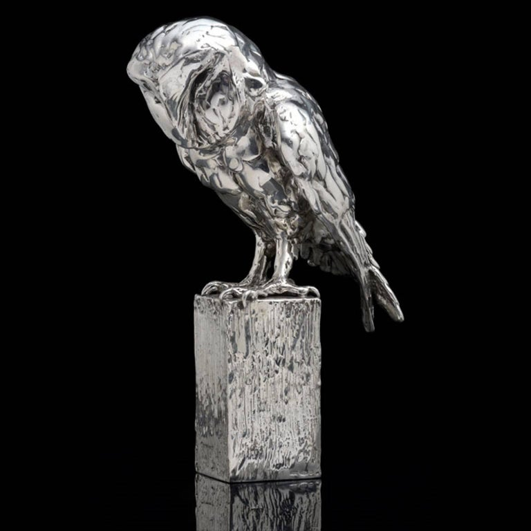 An 'Owl on Post' sterling silver sculpture by Lucy Kinsella, the limited edition finely modelled barn owl perched on the top of a square post, its long curved talons gripping the wood, wings folded close across its back and heart shaped face tilted